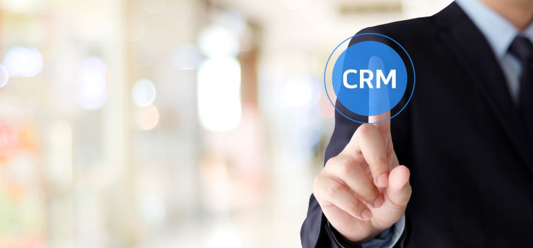 Man in suit clicking a virtual CRM button