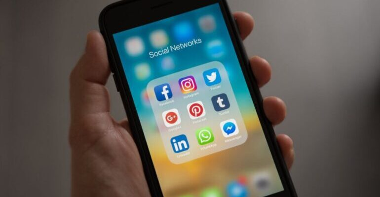 A smartphone screen displaying social media apps.