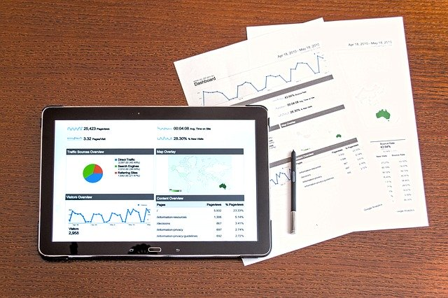 Papers and graphs on a tablet, symbolizing different data types.