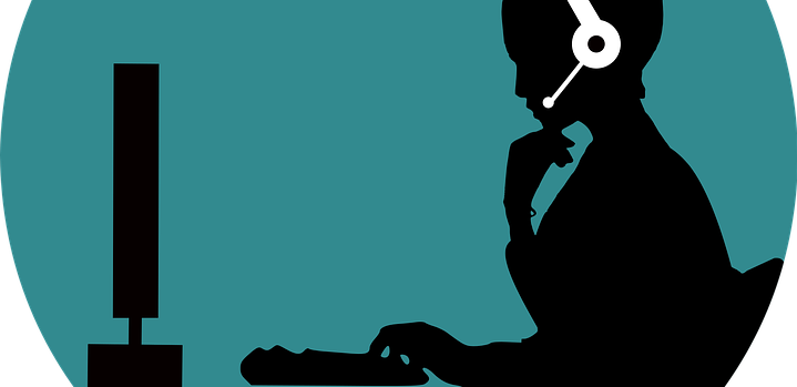 An illustration of a woman with headphones in front of a computer.