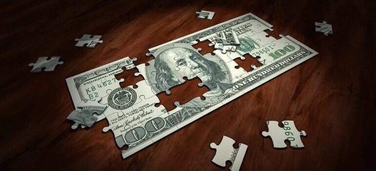 A dollar puzzle on a wooden surface.