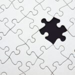 A white puzzle with a missing piece - CRM platform vs point solutions.