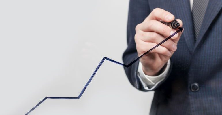 Businessman drawing a scaling line with a marker.