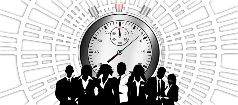 Black silhouettes of people in front of a white stopwatch.
