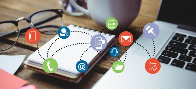 Different email marketing related icons with a laptop in the background.