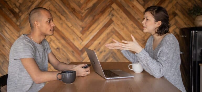 A young business owner talking to a consultant.