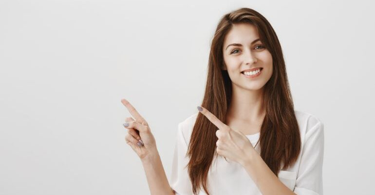 Woman pointing at blank space.