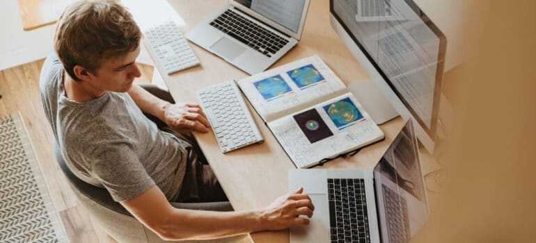 A person working on different computers.
