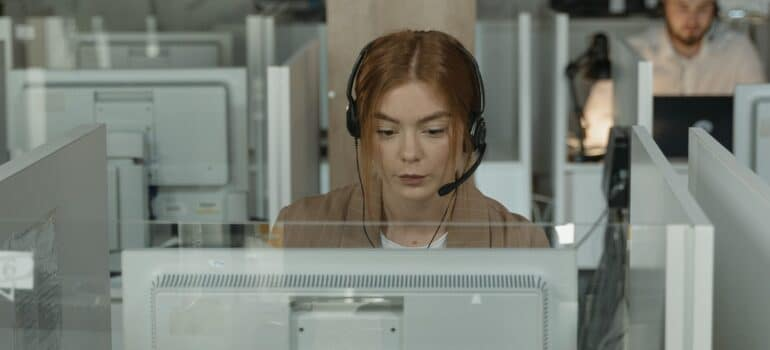 A person working as customer support on a computer.
