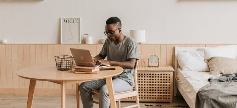 A person working from home, symbolizing the ease of access for customer information provided by the CRM platform.
