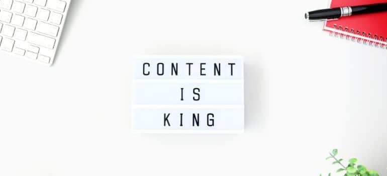 CONTENT IS KING on notepad with white background.