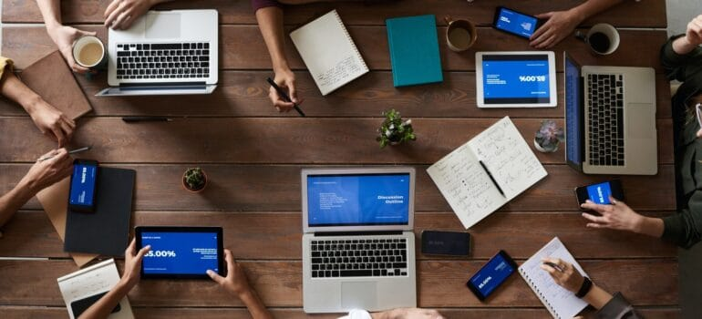 A team working together with the same app opened on different devices.