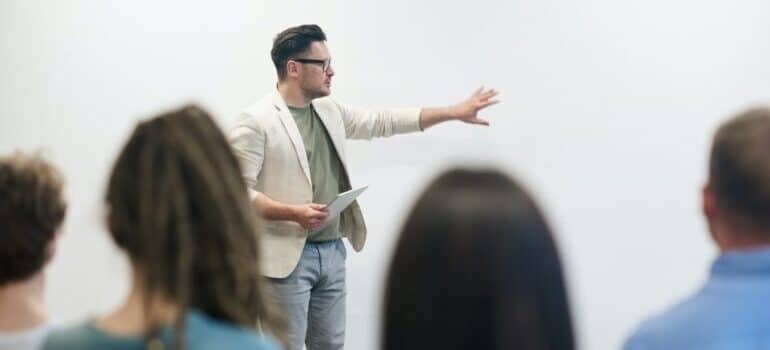 A trainer giving a lecture in front of a group.