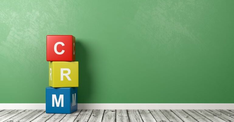 CRM spelled out with differently colored cubes.
