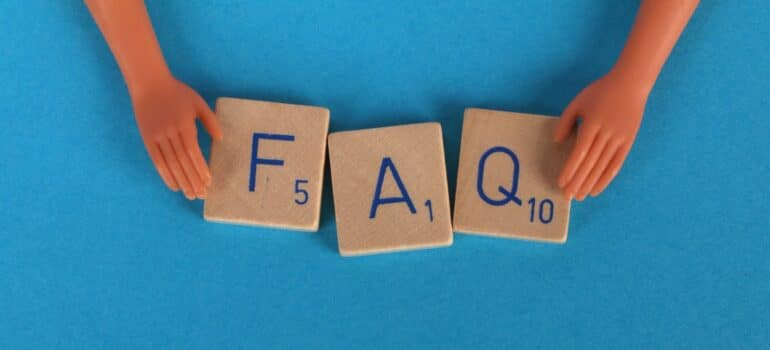FAQ spelled out with wooden blocks.