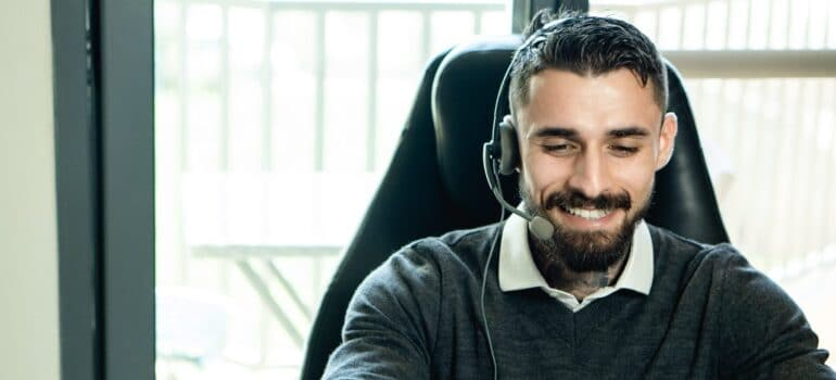 A customer relations agent smiling.