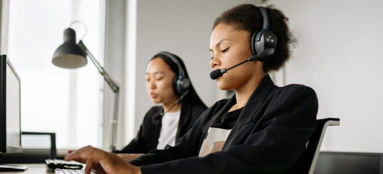 Customer service agents using CRM software.