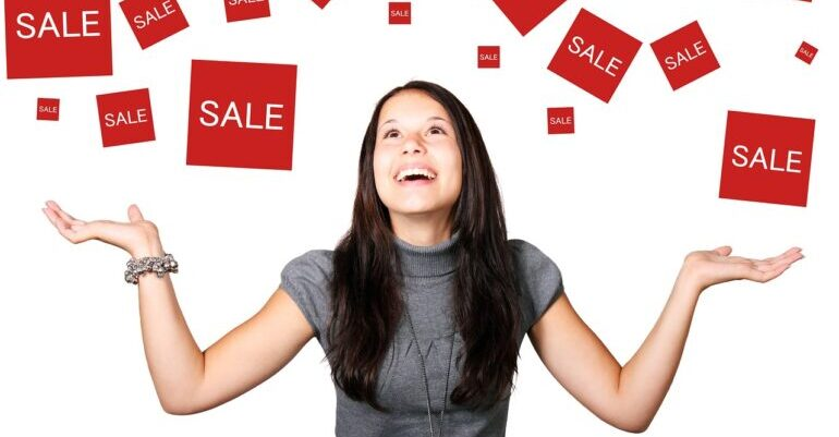 A woman happy because of sale discounts.