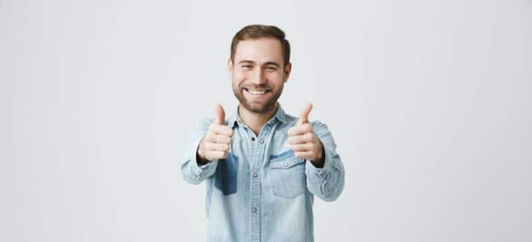A man giving two thumbs up.